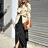Olivia Palermo perfected easy Fall elegance in a draped maxi skirt, belted military jacket, and a pair of Tibi ankle-strap heels.
