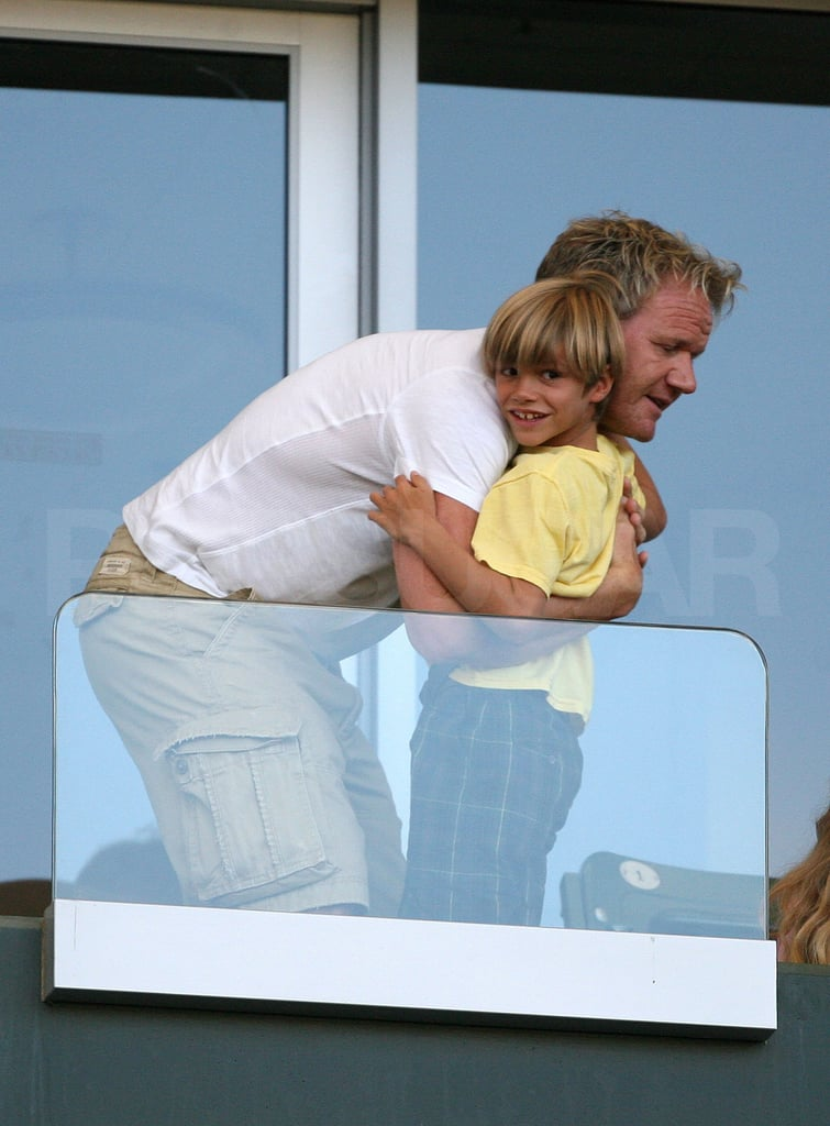 Romeo Beckham hung out in the stands with Gordon Ramsay.