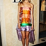 Isabel Lucas celebrated the Christian Dior store in Sydney in a colourful high-low dress from the Spring 2013 collection.