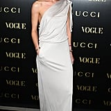 Rosie glowed in this draped asymmetric Gucci dress at an event in London.