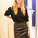 Rosie Huntington-Whiteley looked cool and casual in her leather skirt after walking the runway for Balmain.