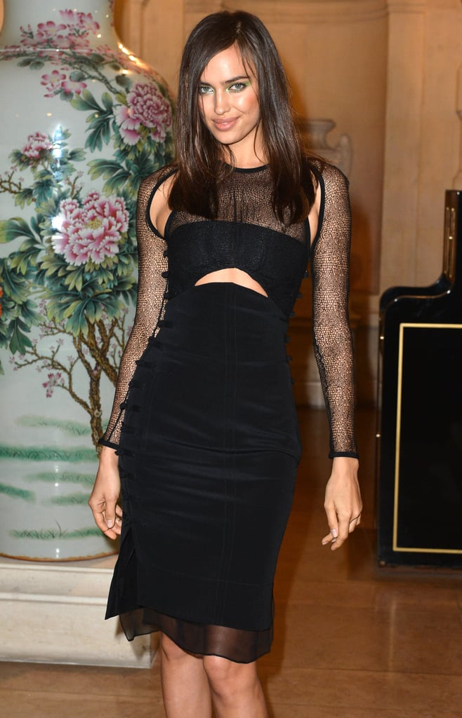 Model Irina Shayk wore a black velvet cut out dress to the CR Fashion Book launch party on Tuesday night.