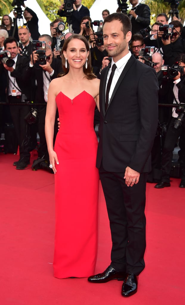 Natalie Portman and Benjamin Millepied had all eyes on them as they walked the famed red carpet at the Cannes Film Festival on Wednesday. The couple, who call France home while Benjamin is the Paris Opera Ballet director, smiled for the cameras and made their way up the grand staircase for the festival's opening ceremony, which was also attended by jurors Sienna Miller and Jake Gyllenhaal. Natalie wore a red gown by Dior Couture for the big event, but she wasn't the only star sporting a gorgeous look since Lupita Nyong'o's flowing green Gucci really stole the show earlier in the day. There's plenty more glamour to come from the historic event, which runs until May 24.
