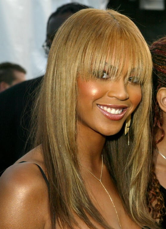 At the 2003 American Music Awards, Beyoncé hid behind some serious eye-grazing bangs. Her sun-kissed cheeks and co-ordinating lip gloss complemented her fringe beautifully.