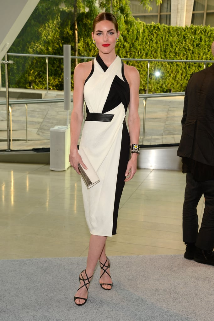 Hilary Rhoda was futuristic in a black and white Helmut Lang dress, while her yellow baubles added a playful twist.