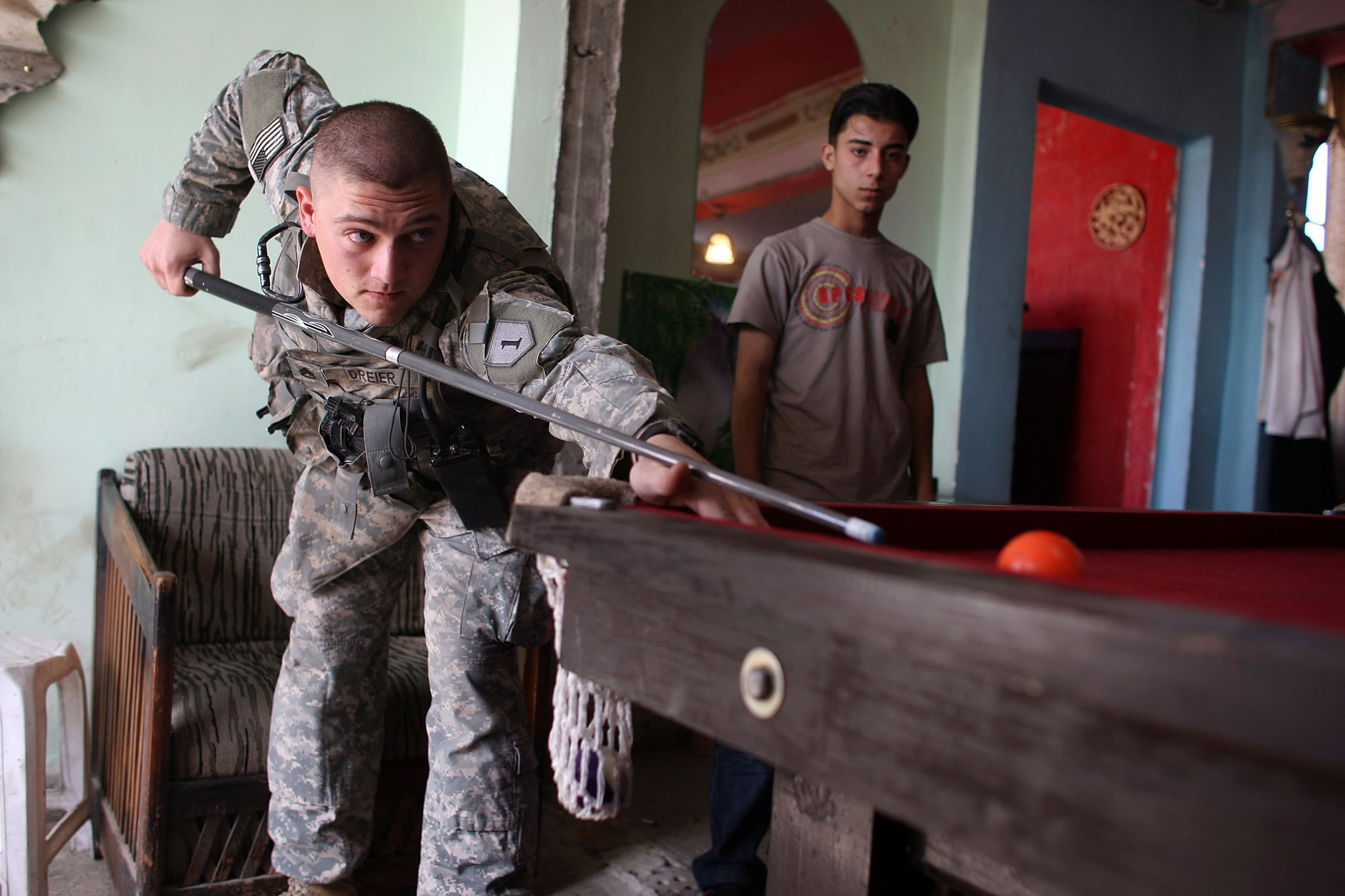 Staff Sgt. Shelby Dreier, from Fawcett, Missouri plays a game of pool at the Doura Guys Cafe while on patrol, March 7, 2008.