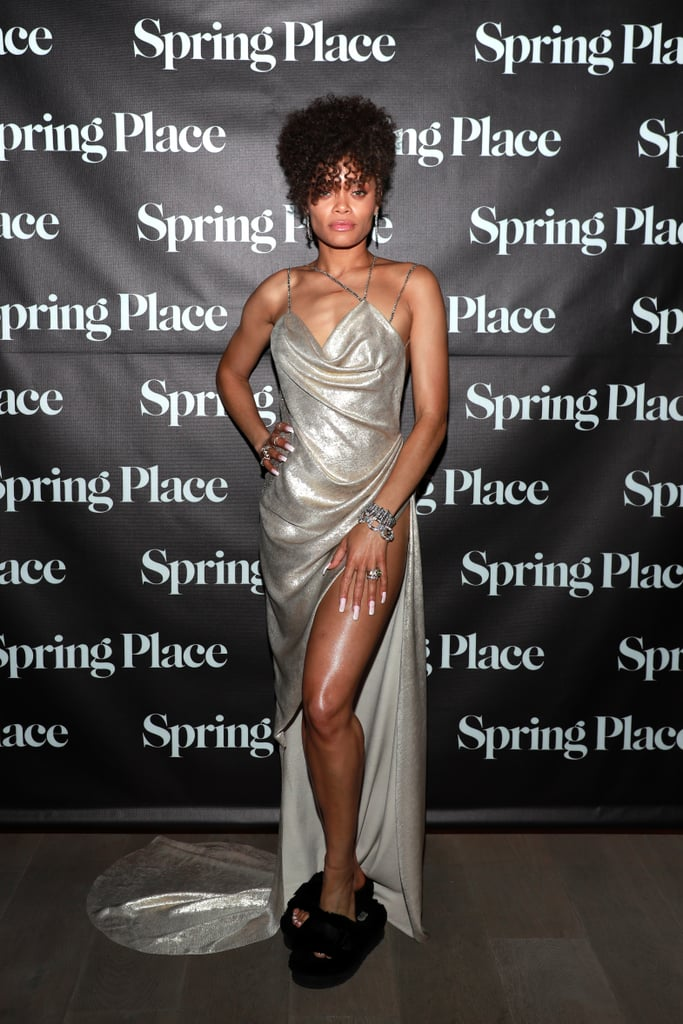Andra Day is having a metallic moment! After wearing a stunning, custom-welded Vera Wang gown at the 2021 Oscars, the United States vs. Billie Holiday star pulled up to her afterparty shining just as brightly. Andra celebrated at Spring Place in Beverly Hills at a party that honored the cast of the Oscar-nominated film, and it was her combination of style and comfort that had us impressed. She rocked a gorgeous metallic Vera Wang Haute dress with a plunging cowl neckline and daringly high leg slit, which has become her go-to style recently. And her choice of footwear was quite possibly the best style we've seen all award season. Andra paired her silver dress with UGG Fluffita Sandals that had *just* the right amount of platform to complete the afterparty look. The real question is, why aren't we wearing fuzzy sandals with dresses to every function? Check out Andra's gorgeous Oscars afterparty look, and get inspired to swap your heels for slippers at your next big event.      Related:                                                                                                           We'd Like to Thank the Academy For Letting Us Witness These 2021 Oscars Red Carpet Looks