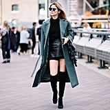 We love that Rachel always wore black tights with her miniskirt, but for a modern take on that look, we recommend the knee-high boots instead. Add a gorgeous colored coat over the whole look, and you will be turning heads left and right.