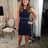 Molly Goodson went for a streamlined look in a navy-blue dress by Rag & Bone.