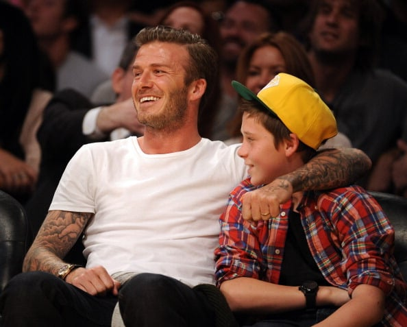 David and Brooklyn Beckham got cute at a basketball game in LA in March 2012.