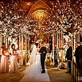 A cherry blossom backdrop is made even more romantic with orchids cascading from the trees.