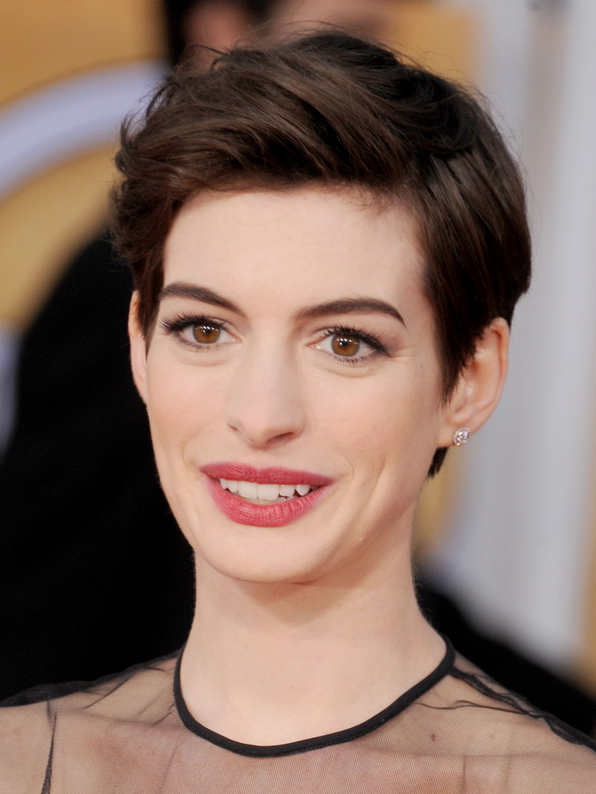 When you want to get short hair out of your face, try Anne's look from the SAG Awards. Use a bit of pomade and a blow dryer to smooth bangs up and back.