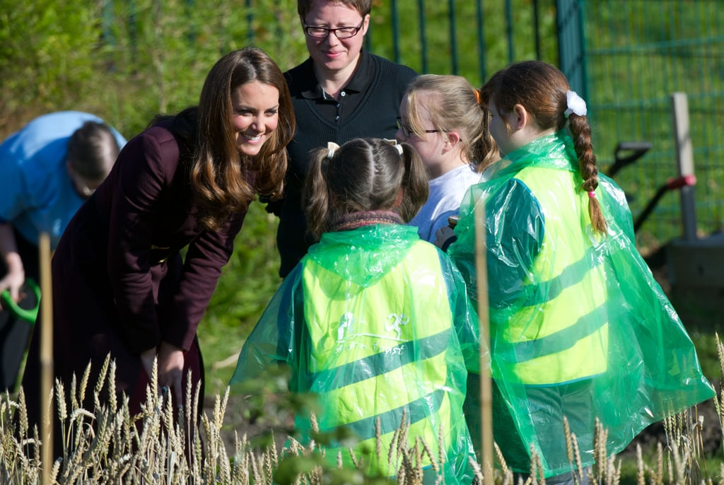Kate Middleton met with a group of girls while visiting a community garden in England in October 2012.