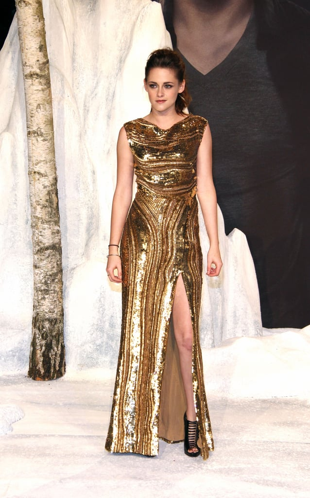 Kristen Stewart's golden Elie Saab would be the ultimate NYE dress — gilded and gorgeous, and with a leg-flaunting slit!