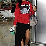 Side-slit maxi skirt, Converse, and a USA Gucci bag? Rihanna's London travel style was unparalleled in August 2012.