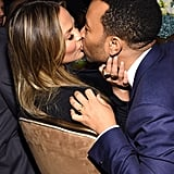 Chrissy Teigen and John Legend shared a passionate kiss at Clive Davis's gala.