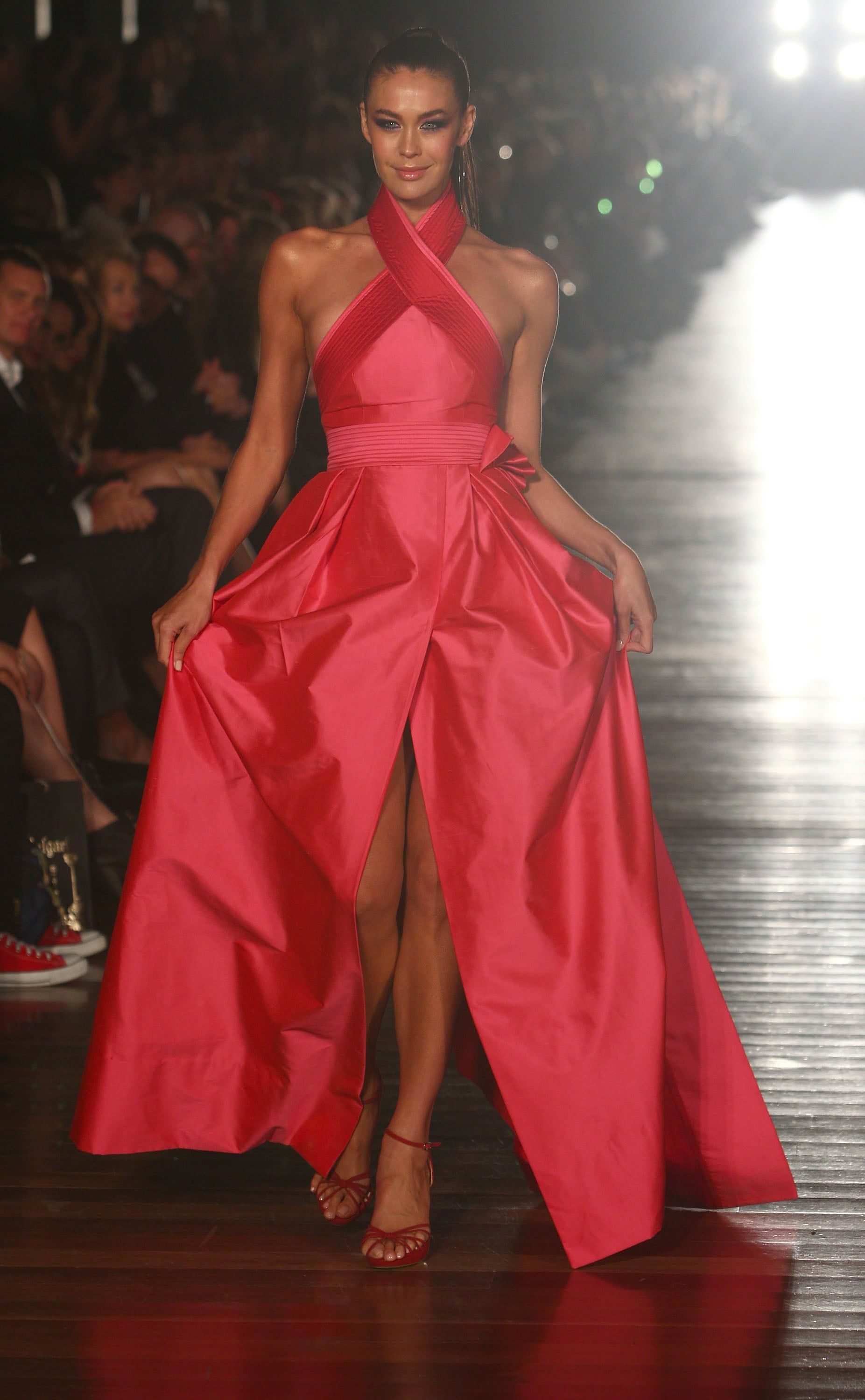 Megan Gale rocked this dramatic red gown down the runway for Alex Perry's LMFF show.