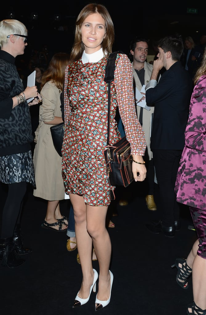Dasha Zhukova, at Gucci, went the prim-and-proper route in a collared printed dress look, only punching it up with a cap-toe pump.