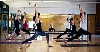 Clubbell Yoga Is So Much More Than a Trend — It's the Ultimate Way to Get Fit