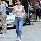 On the set of her new movie, Selena dressed down in a tank top, frayed Joe's jeans, and Golden Goose sneakers, which she's been wearing nonstop.