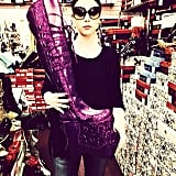 Michelle Trachtenberg scoped out a pair of massive purple boots as she put the finishing touches on her Halloween look.