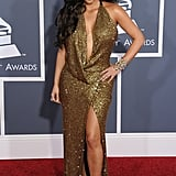Kim Kardashian rivalled Jennifer Lopez in a sexy gold dress at the February 2011 Grammys in LA.