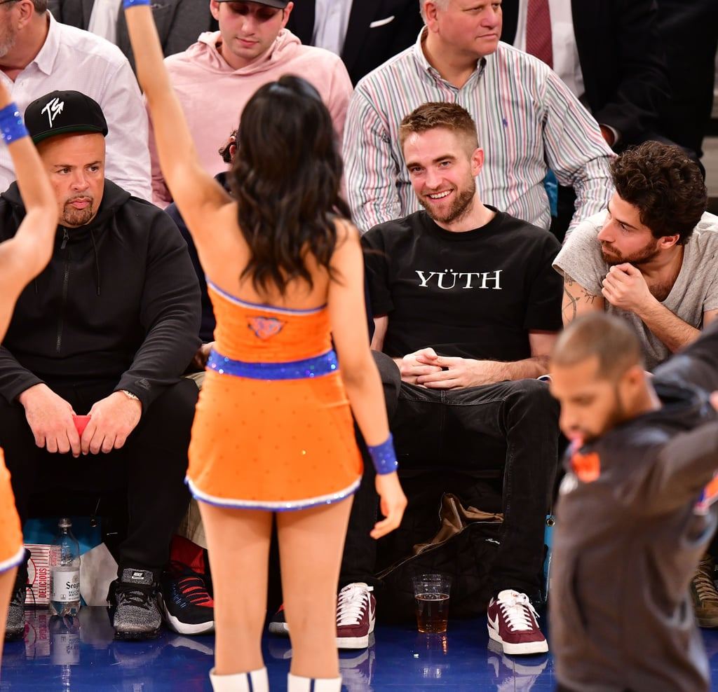 "Robert Pattinson sat courtside to watch the New York Knicks take on the Miami Heat on Wednesday, but it was during half-time that the real show started. The attractive actor was snapped in the stands with friends looking very entranced as the Knicks City Dancers performed; a couple women in general seemed to capture Rob's attention, as he was seen keeping his eyes on them while grinning.  It was reported in October that Rob and singer FKA Twigs had ended their engagement after three years of dating. ""They broke up several months ago,"" a source told Just Jared at the time, adding that ""their travel schedules took a big toll on the relationship"" and that Rob initiated the split. Signs pointed to trouble in paradise after FKA Twigs was photographed spending time with French model Brieuc Breitenstein in Ibiza, Spain, in August. After the split, Rob was said to have leaned on his pal Katy Perry for support. Judging by these photos, could it be safe to say that Rob is ready to get back on the dating scene?"
