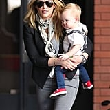Hilary Duff cradled Luca Comrie on their way to Babies First Class in LA on Wednesday.