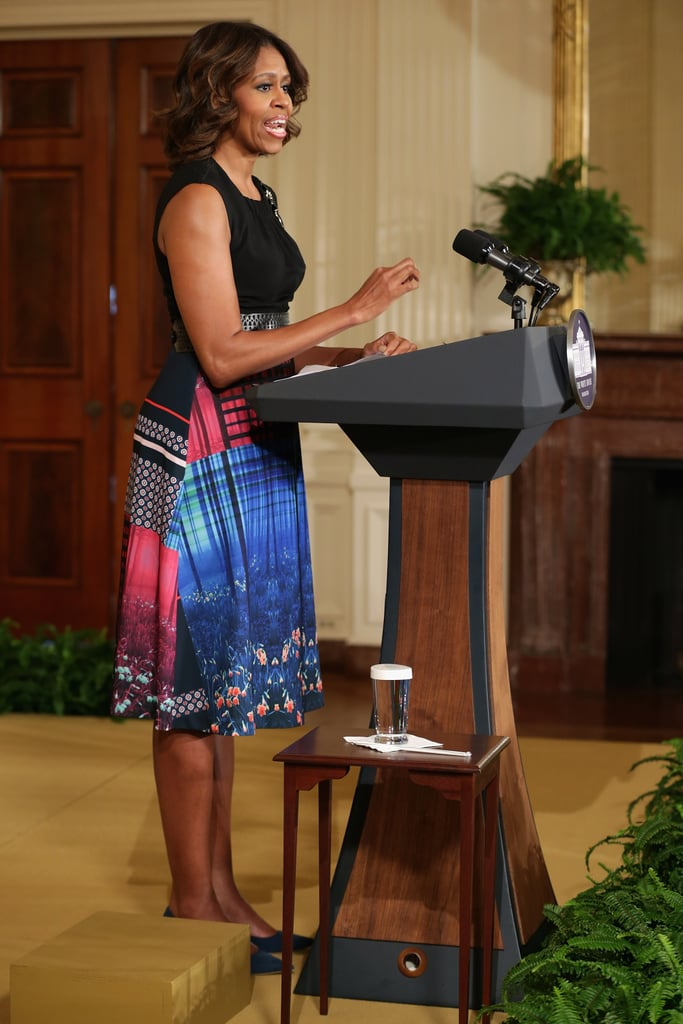 Michelle announced the Mayors Challenge to End Veteran Homelessness in a colorblock sheath that she completed with a perforated belt and a flower brooch. All the elements come together and work for her — proof that she's truly a sartorial wonder.