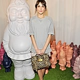 Alexa Chung wore Mulberry's Velvet Tee in Grey Marl Cotton, Eliza T-Bar Ballerinas in Dark Blush, Lace Trim Shorts in Pinky Mink from the Autumn Winter 2012 Collection and carried the Alexa Mini-Maxi Giraffe Haircalf from the Spring Summer 2013 Main Collection.