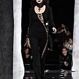 Bella showed off a sexy lace-up jumpsuit and thick leather choker necklace on Rihanna's runway.