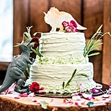 This wedding party ditched the traditional cake toppers for quirky toy dinosaurs and rustic frosting detail.