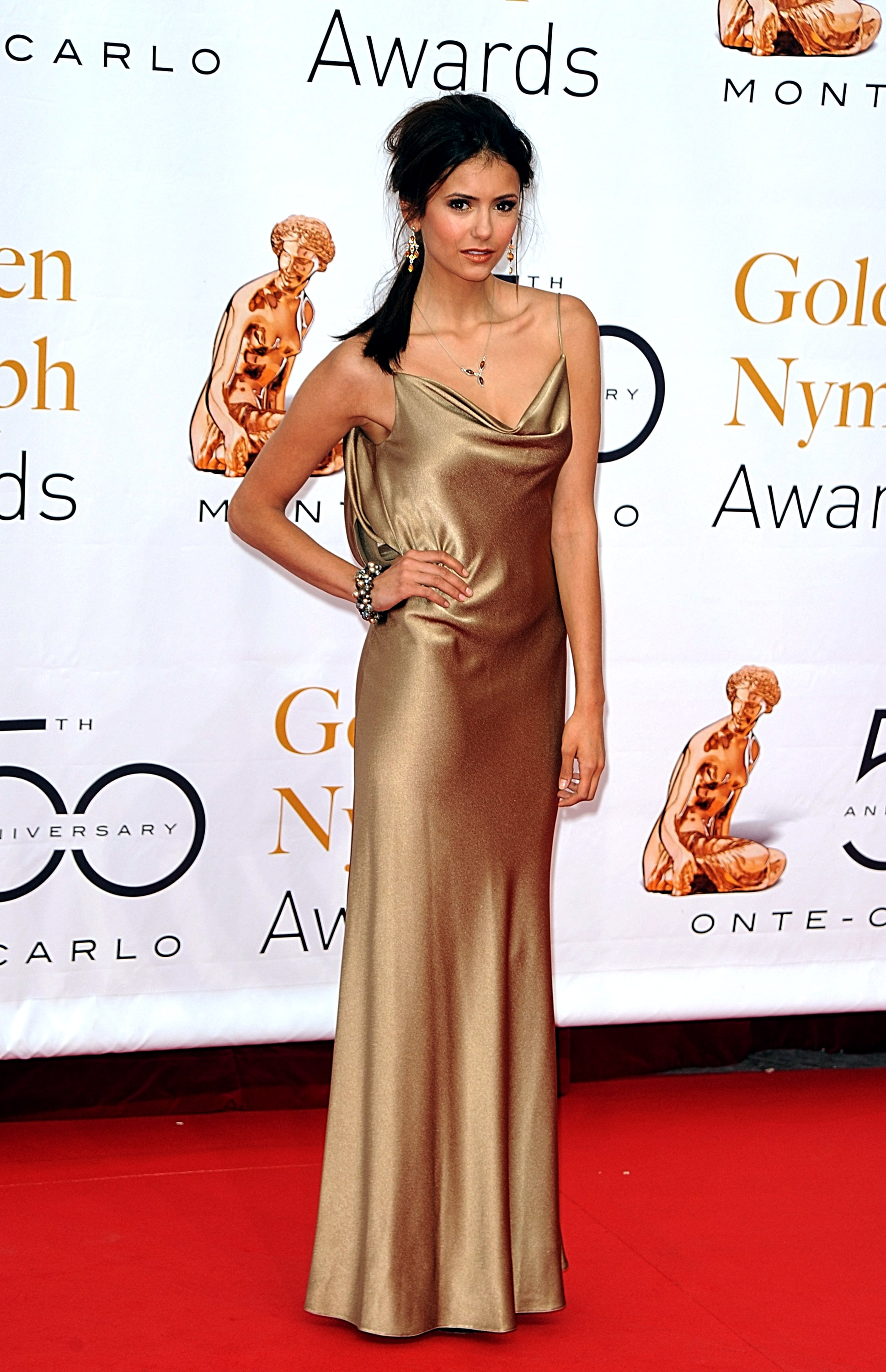 She stunned in a liquid gold gown at the 2010 closing ceremony of the Monte Carlo television festival.
