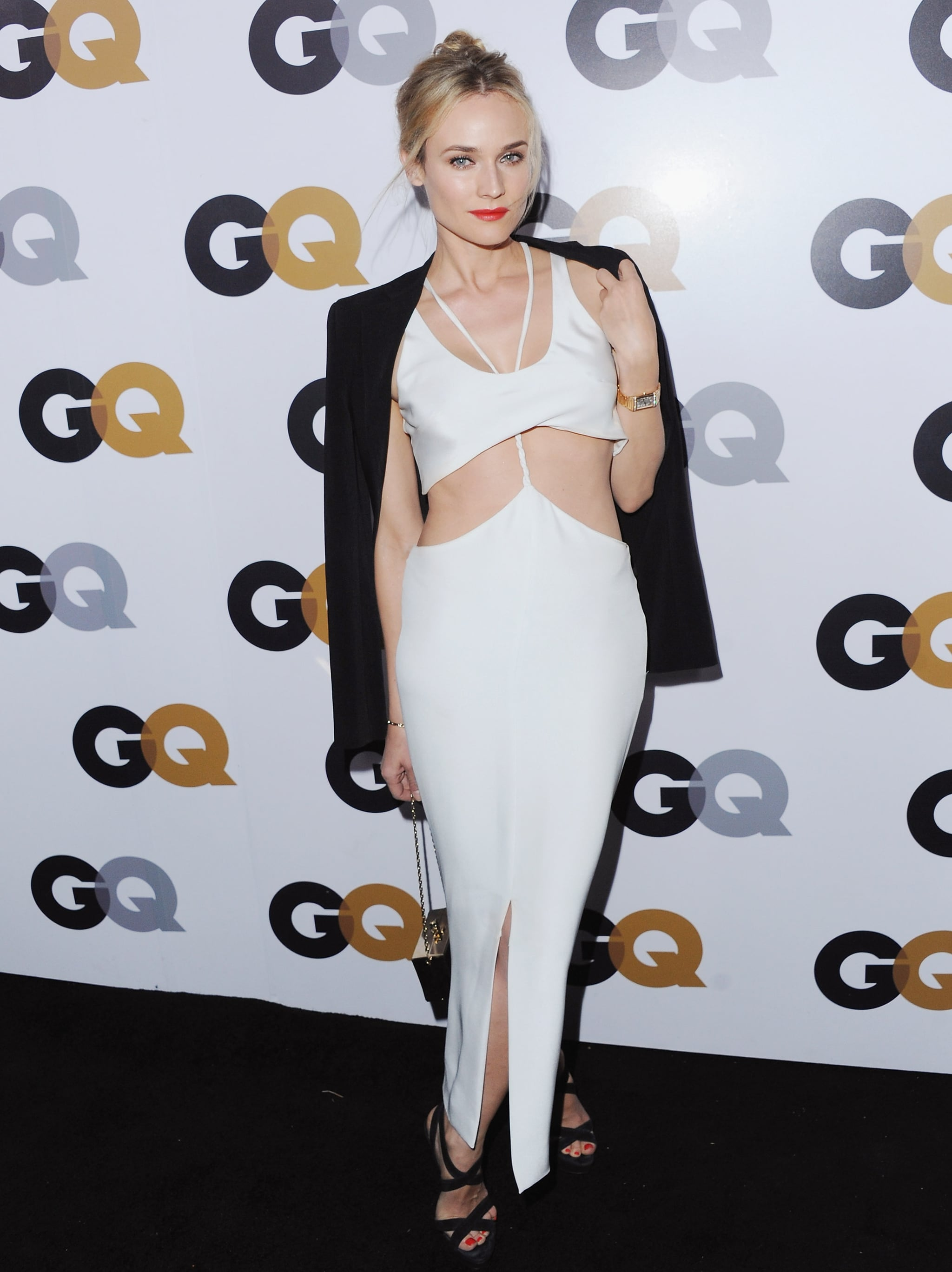 Diane Kruger tempered her sultry white cutout Cushnie et Ochs dress with a black Vanessa Bruno blazer and strappy Jimmy Choo sandals at GQ's 2012 Men of the Year Party.