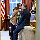 Malia's happy to give her dad a helping hand.
