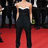 Victoria Beckham wore a black and white-trimmed Victoria Beckham jumpsuit and Chopard jewellery to the Café Society premiere.