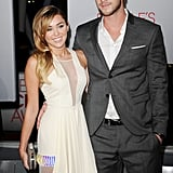 Liam Hemsworth was by Miley Cyrus's side at the People's Choice Awards.