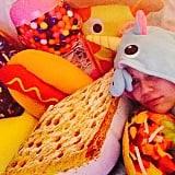 Miley Cyrus cuddled up with some food pillows.