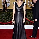 Julie Bowen edged up the competition in a black leather Johanna Johnson gown with crystal-embellished shoulders and strappy Jerome C. Rousseau sandals.