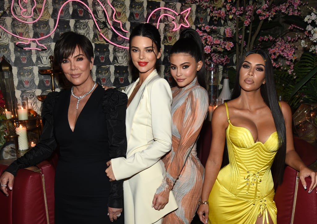 """Kim Kardashian was joined by her mom, Kris Jenner, and sisters Kylie and Kendall Jenner for a night out at the Business of Fashion issue launch event in NYC on Tuesday night. True to form, Kim showed off her famous figure in a curve-hugging yellow Versace dress, echoing the design she wore to the Met Gala earlier this week. Kim covers Business of Fashion's recent Age of Influence issue. Inside the event, she posed for photos with pals Padma Lakshmi and LaLa Anthony. All four Kardashian-Jenner ladies were in attendance at the Met Gala on Monday night. Kylie made her red carpet debut with boyfriend Travis Scott, and the couple shared some sweet PDA while posing for photos. While Kim was solo at the event, she made sure to tweet a message to husband Kanye West, saying, """"Wish you were here."""" Kanye, who has sent out his own spate of controversial tweets recently, is currently finishing up his album in Jackson Hole, WY."""