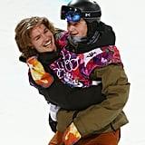 Switzerland's Iouri Podladtchikov and David Habluetzel hugged after competing in the snowboard men's half-pipe finals.