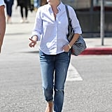 Reese jazzed up her smart style with navy Valentino flats and a monogrammed Goyard tote in West Hollywood.
