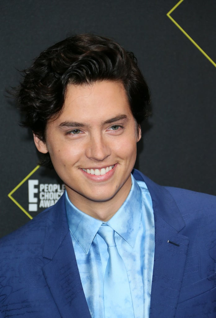 Cole Sprouse was all smiles while looking blue on the 2019 People's Choice Awards red carpet. The actor, who ended up taking home the award for drama movie star of the year, wore a blue monochromatic suit with a tie-dye shirt and a matching tie. The look was made even more interesting by the zippers at the hems of his pants.  Cole has become known for his daring style, with his most memorable outfit to date being the floral Ferragamo suit he wore to the Met Gala earlier this year. See pictures from his latest cool red carpet appearance ahead.      Related:                                                                                                           The People's Choice Awards Red Carpet Was Like a Casting Call For the Hottest Dresses of the Year