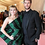 Liam Hemsworth is also wearing Saint Laurent.