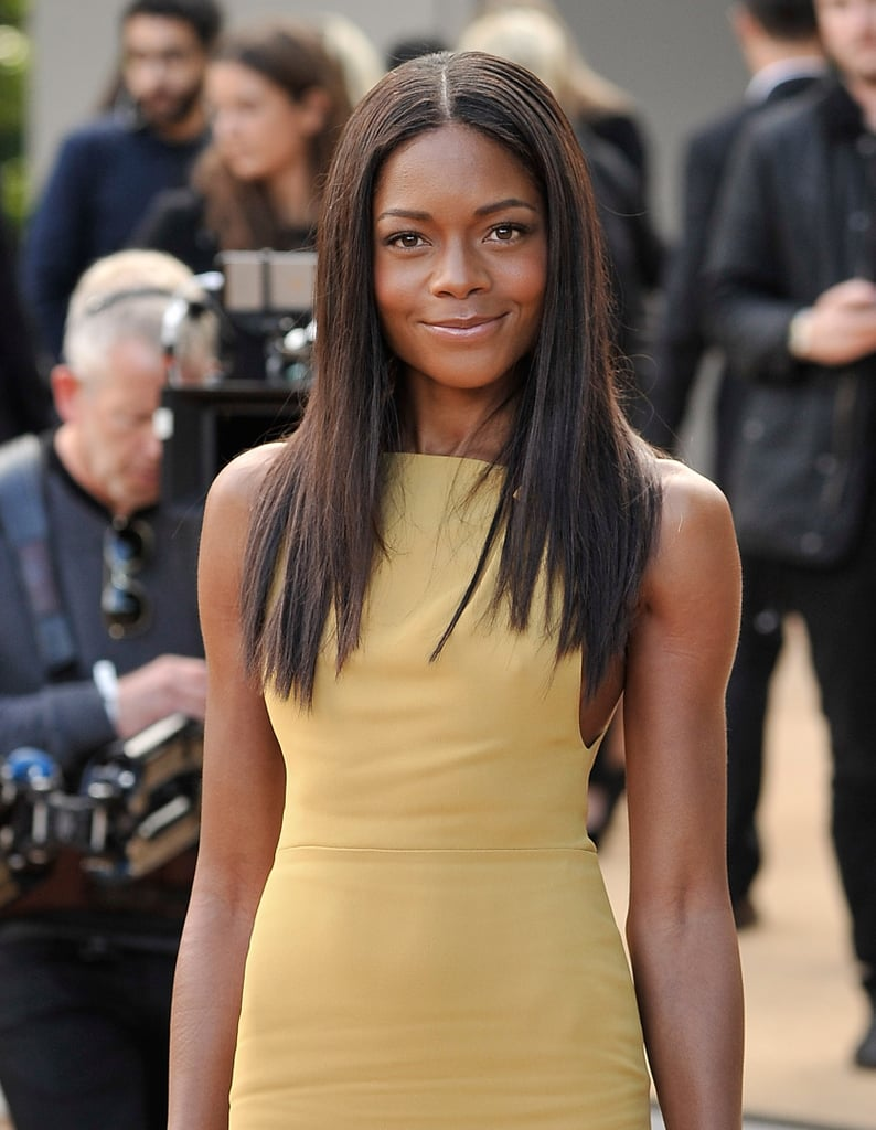 Naomie Harris amped up the glam factor at Burberry Prorsum's Spring 2014 presentation when she showed up in smooth, silky strands.
