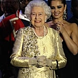 The queen smiled in gold at the Diamond Jubilee Concert at Buckingham Palace.
