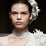 At Yiqing Yin, hair was embellished with coral-like pieces, while makeup was left neutral.