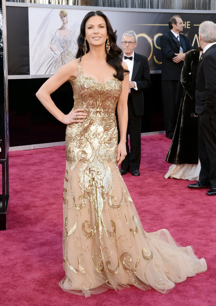 Catherine Zeta-Jones shined in a metallic gold dress on the Oscars red carpet.