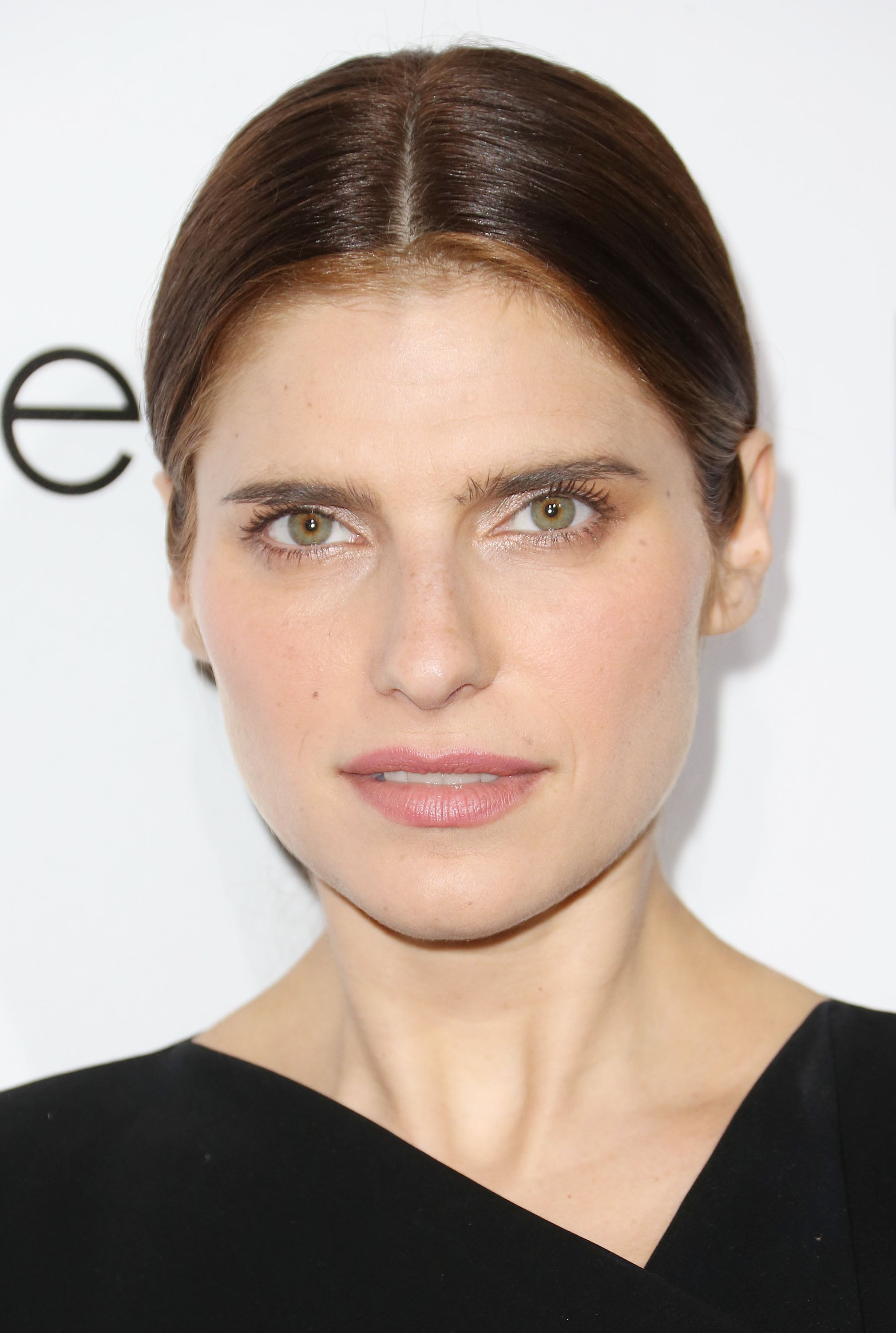 Lake Bell loves a neutral makeup palette. So, she went for a bevy of pale pinks on the Elle red carpet. Her hair was styled with a deep middle part and nape-grazing pony.