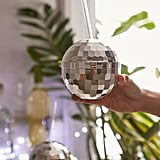 It's easy to recreate a boogie nights vibe in your apartment with these flashy disco sippers ($8).